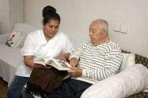 Aide helps elderly man read