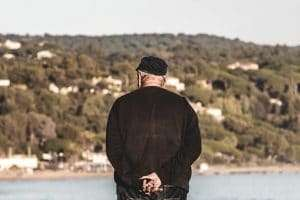 elderly man watching the sea