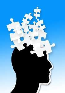 silhouette of head with puzzle pieces