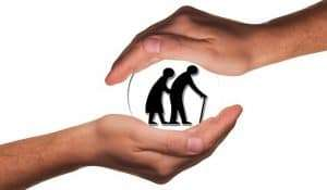 two hands holding a silhouette of an elderly couple
