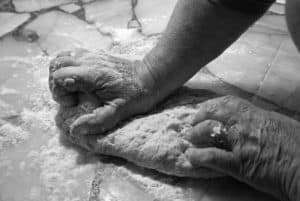 hands kneeding bread