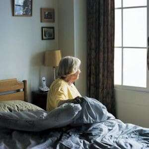 How to help an elderly person get in and out of bed safely