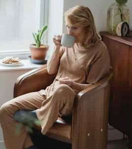 older woman living alone drinking tea
