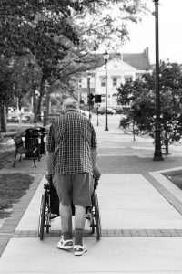 man pushing a wheelchair