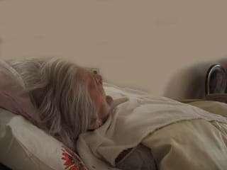 elderly lady in hospital bed