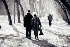 senior couple walking on icy path